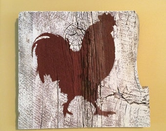 Rooster silhouette on whitewashed barnboard
