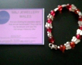 Red beads and butterfly