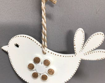 White and gold wooden hanging bird