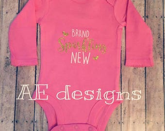 Welcome new baby bodysuit. brand sparkling new. worth the wait. pink. sparkles. bodysuit. infant. creeper. new baby. coming home outfit.
