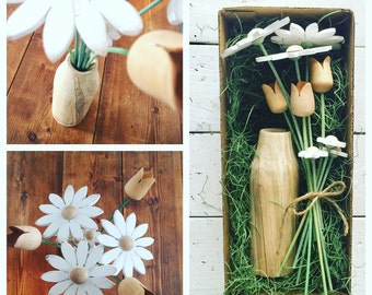 Hand crafted wooden vase and flowers.