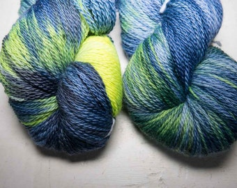 Hand dyed yarn in deluxe 100% merino. Midnight Glow colourway