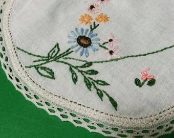 Vintage hand embroidered doily with crocheted edge