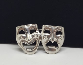 Sterling silver comedy and tragedy pin.