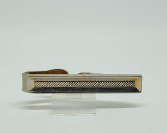 Men's gold tie clip.