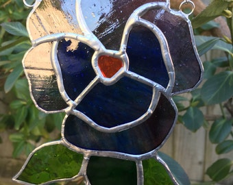 Hand crafted stained glass multi coloured Pansy sun catcher.