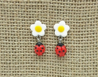 Ladybirds (ladybugs) polymer clay earrings with white and yellow flowers