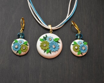 White and blue floral pendant and earrings set.