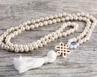 """White pearl and blue laced agate mala necklace with a Endless tibetain knot accent - 34"""" inches long"""