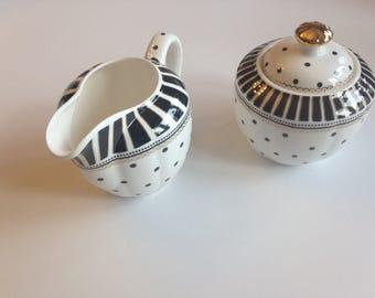 Ceramic cream and sugar containers