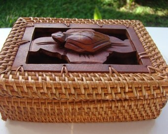 Box turtle sculpture and woven rattan wood