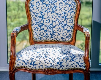 Repaired retro armchair from 1930 years
