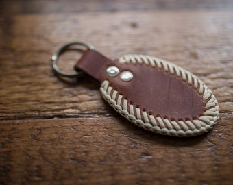 Laced leather keychain