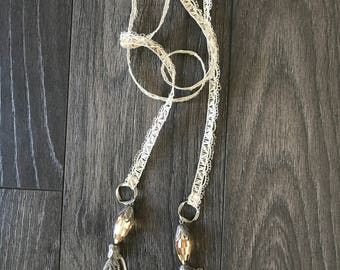 Necklace/scarf with metal tassels with crystal beads