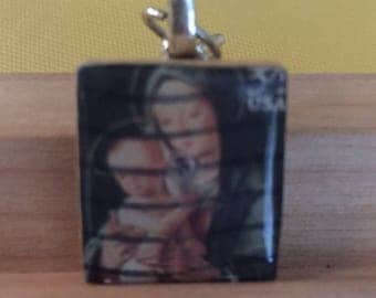 Left Facing Holy Mother & Child Postage Stamp Pendant