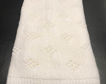 Hand knit white baby blanket diamond pattern