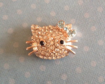 Connector pink Hello Kitty in rhinestone gold/gold