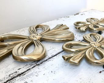 RESERVED FOR TEFI Set of three vintage tablemats / brass knot shaped tablemats / brass ribbon bow tie / 1950s
