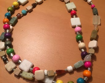 Along multicolored and assorted bead necklace