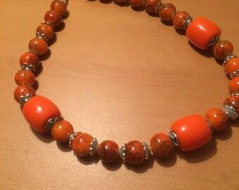An orange bonanza! made of orange colored and exotic beads