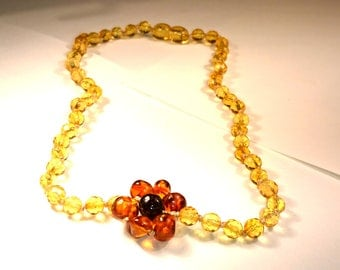 Natural Baltic Amber Children Necklace with a Cognac and Matte Flower and Lemon and Cherry Beads
