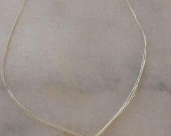 """White Silk Thread """"Om"""" Necklace"""