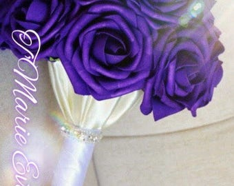 Purple bouquet with white handle satin