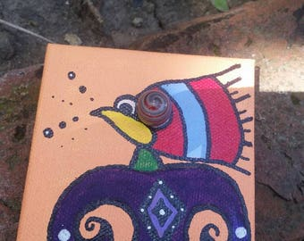 Bird chief magnet with glass marble eye