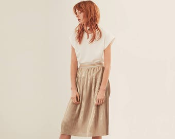 Pleated shiny gold skirt