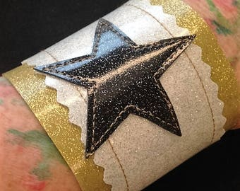 Sale!  Sparkle vinyl black star cuff.