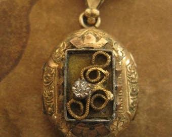 Victoria ~ antique locket steel cut necklace