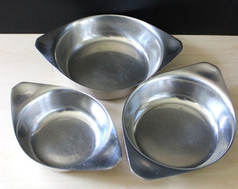 Vintage stainless steel nested bowls, Scandinavian modern design. Set of three.