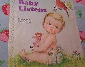 baby listens cloth book