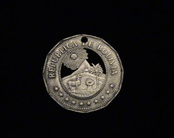 Bolivia - cut coin pendant - Alpaca  smiling sun and   mountains - 1972