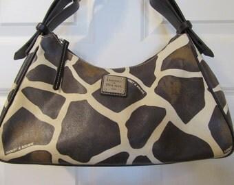 Beautiful authentic leather giraffe design Dooney and Bourke handbag in very nice condition- great design