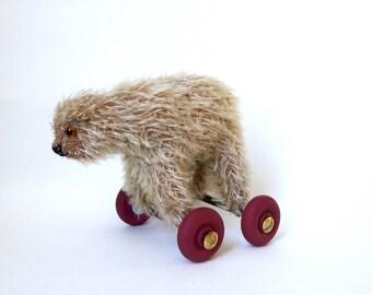 lambchop- a little  bear on wheels
