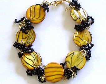 Black and Yellow Striped Mother of Pearl Disks with Black and Gold Woven Fringe Bracelet Carol Wilson of Je t'adorn