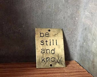 be still and know - blackened brass passages plaque