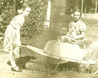 Trick Photograph / Girl Pushing Herself and Cat in a Wheelbarrow /1910s RPPC