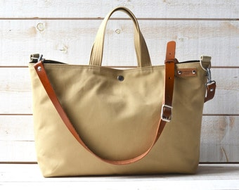 Sand canvas tote bag, Carry all, Diaper bag, Messenger bag, Work bag, Leather straps, Travel bag, Zipper and 2 Pockets