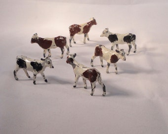 Vintage Miniature Herd of COWS Cast Metal Figurines. Made in England. 10 Spotted Cows.
