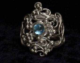 Handmade sterling silver ring with topaz
