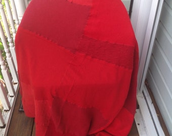 Handmade soft red wool patchwork throw blanket. Bedding. Sleep.