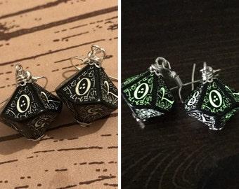 flourescent D100 dice earrings rgp glowing in the dark ewrrings black inscriptions elvish runes fantasy dungeons and dragons dice d20