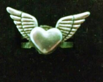 Cute heart with wings pewter and brass adjustable ring pretty!  Make sure to check out my other listings.  Lots of OOAK (one of a kinds).