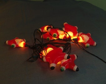 Christmas Light Covers for mini lights, 10 Santas, String is Indoor or Outdoor, Hard Plastic