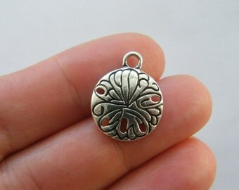 4 Sand dollar charms antique silver tone FF355