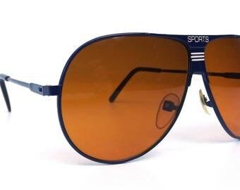 vintage 80's deadstock aviator sunglasses navy blue metal frames amber orange lenses sun glasses eyewear oversized blu blockers driving 145