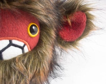 Severed Pygmy Sasquatch Head... brown & rust faux fur