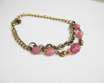 Gold Toned Metal Chain Bracelet with Pink Faceted Beads